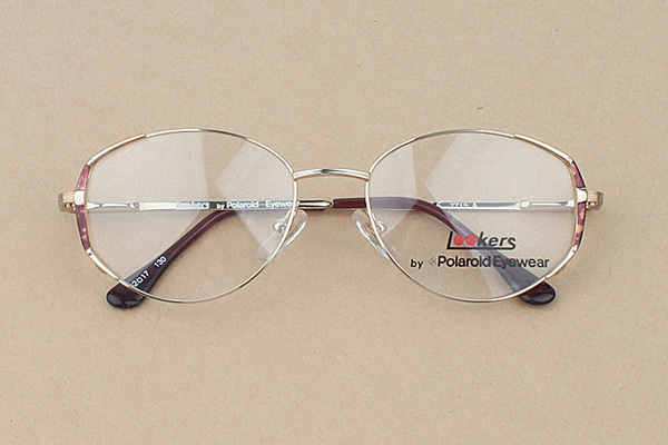 vtg-477Lookers by polaroid eyewear gold rim